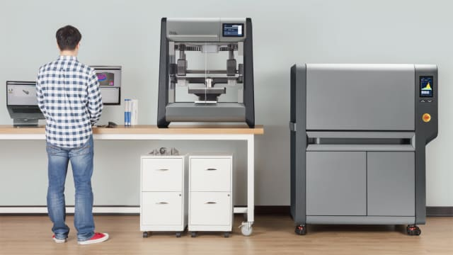 The DM Studio System is described as the first office friendly metal 3D printer. On the right is the microwave-enhanced sintering furnace. (Image courtesy of Desktop Metal.)