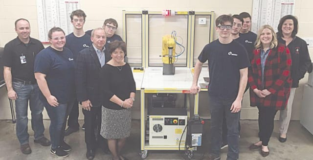 HCTC Machine Tool students gather with representatives from the Henry A. Jubel Foundation after showcasing their robot programming skills. (Image courtesy of HCTC.)
