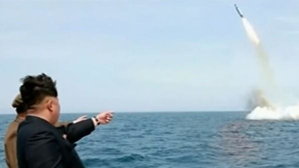 Kim Jong Un photographed with a submarine-launched missile in 2015. (Image courtesy of Youtube.)