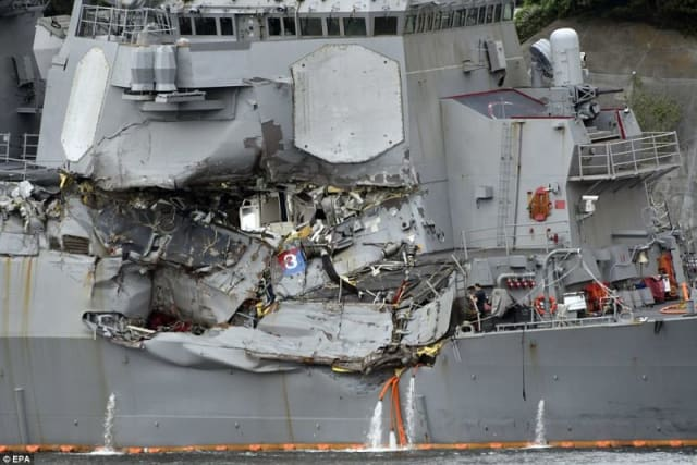 The wreckage caused by the ACX Crystal upon impacting the USS Fitzgerald. The United States Naval Institute reported that the captain of the USS Fitzgerald was in his cabin at the time, meaning he and his crew could have been focused on other maneuvering threats detected before a minimum CPA from the ACX Crystal was established. (Image courtesy of EPA).
