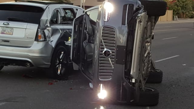 Uber's Volvo goes through an orange light at 38 mph, hitting a Honda CD-V and two other cars, before turning on its side. No one was killed. The driver in the Honda was issued a ticket for failure to yield. (Image courtesy of Fresco News.)