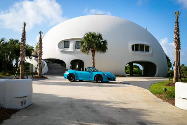 "Nicknamed ""Eye of the Storm,"" this monolithic concrete home is resistant to high winds. (Image courtesy of Pareto Group.)"