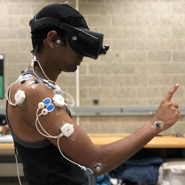 Motion capture and electromyography sensors measure a study participant's movements and muscle activity while performing common VR gestures. (Photo courtesy of Jay Kim.)