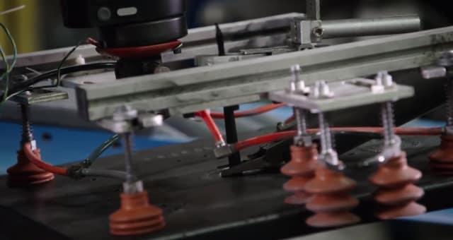 Rethink Robotics' Sawyer collaborative robot tends to a degating process at Harrison Manufacturing. (Image courtesy of Rethink Robotics.)