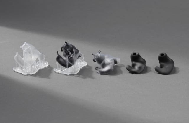 bbe80582949 On the left is a wearer-specific mold, 3D printed with Formlabs' clear