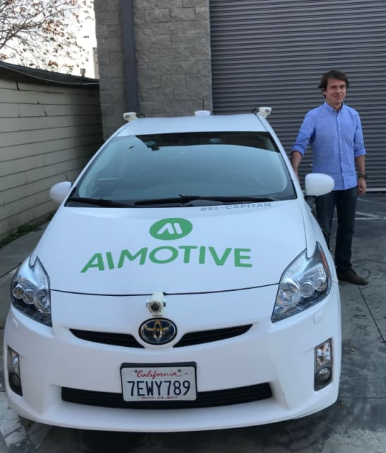 László Kishonti, AImotive founder and CEO, with El Capitan, a well-instrumented self-driving Prius that took us for a ride on the highway.