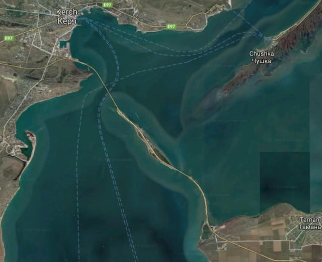 Composite satellite image of the completed bridge, stretching from the Crimean Peninsula (left) to Russia's Taman Peninsula (right). Approximately one-third of the bridge passes over Tuzla, an island that legally belongs to Crimea (Image courtesy of Google Maps.)