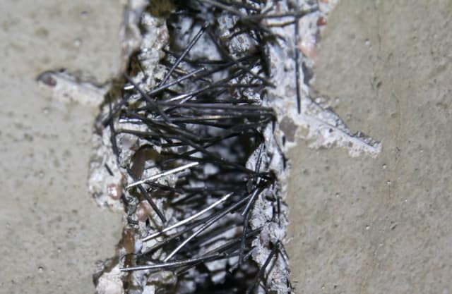 SFRC holding a concrete slab together after it has cracked. (Image courtesy of Euroquartz.)