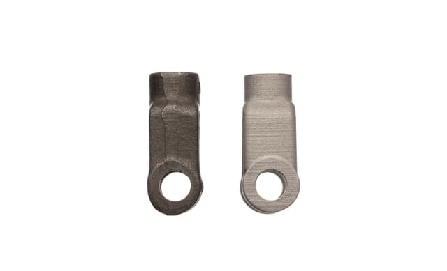 (Right) A yoke for a brake assembly produced with the DM Studio System as a replacement part for heavy machinery. (Left) The original part that was cast and machined. (Image courtesy of Desktop Metal.)