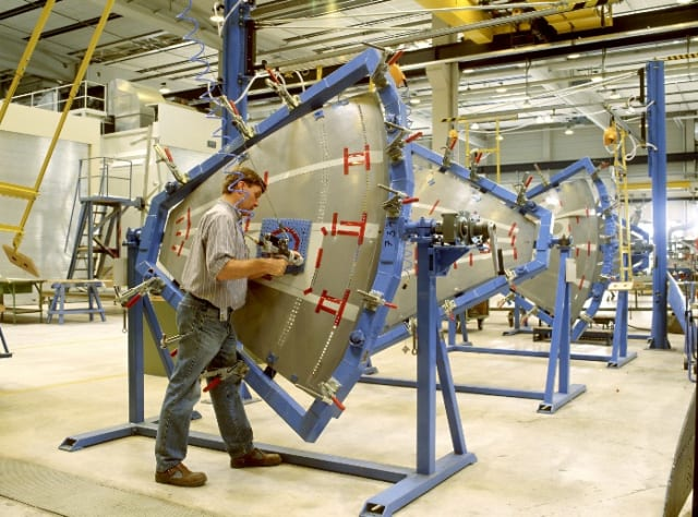 Manual drilling and filling of an aerospace assembly in a jig.