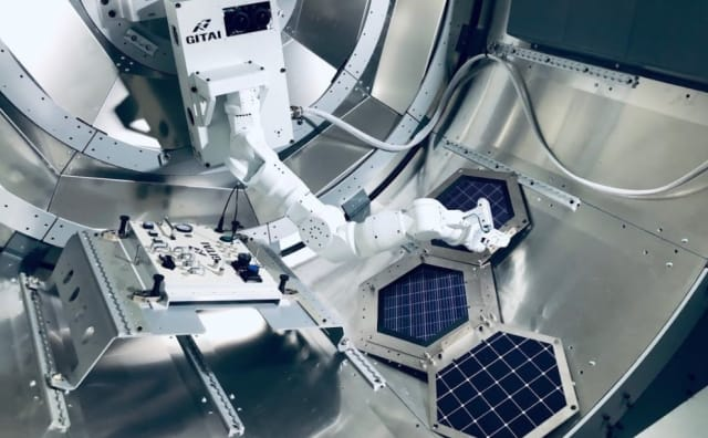 A GITAI robot performs work during a ground experiment inside the Nanoracks Bishop airlock. (Image courtesy of GITAI.)