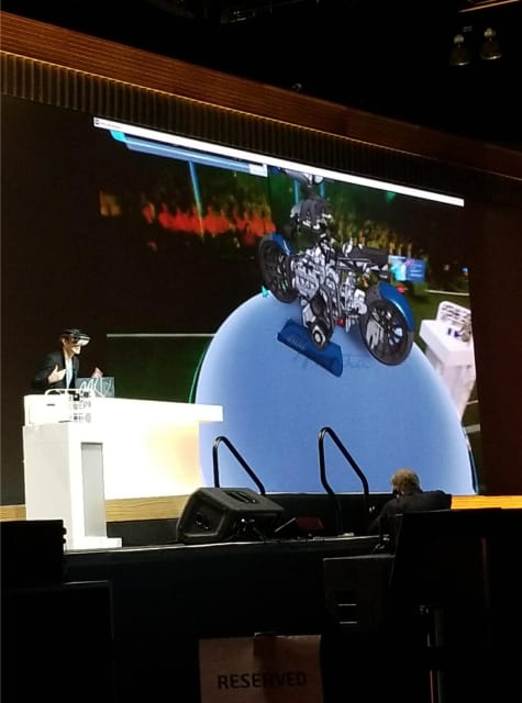 Meta CEO Meron Gribetz plays with an AR motorcycle on stage at SOLIDWORKS World.