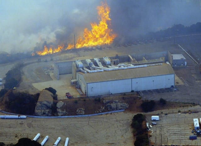 The Woolsey fire started in the Santa Susana Field Laboratory from the local power company's equipment and is alleged to have spread radiation far and wide. (Image courtesy of Associated Press)