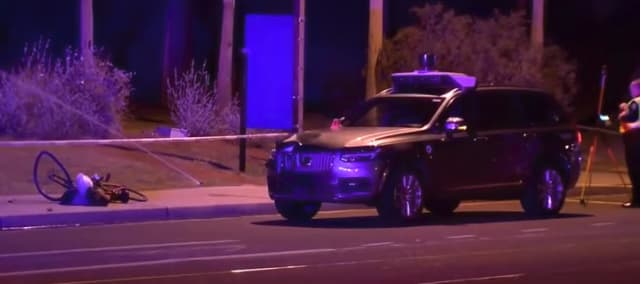 "Elaine Hertzberg was killed walking her bike across a road in Tempe, Ariz. when struck by an Uber self-driving car. The vehicle was operating in autonomous mode with a ""safety driver"" at the wheel. (Image courtesy of ABC local news affiliate.)"