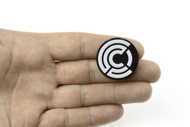 A multimaterial 3D-printed tag with embedded NFC chip. (Image courtesy of Origin.)