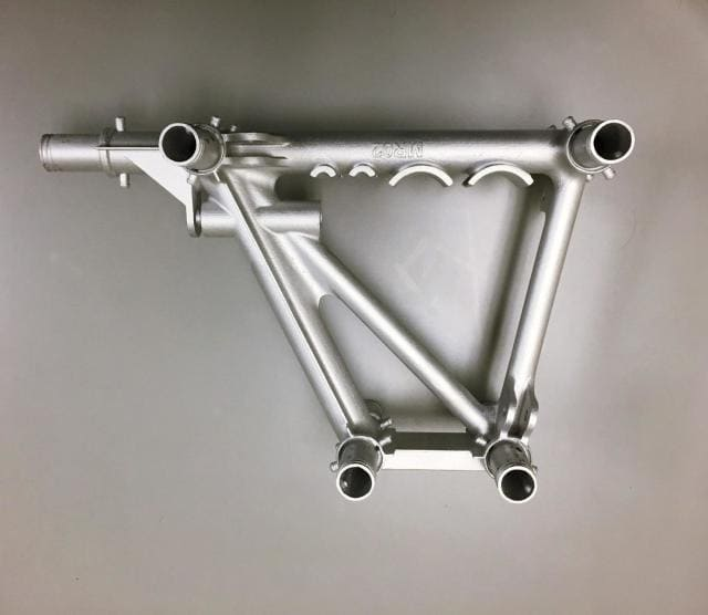 A 3D-printed NODE aligns and self-fixtures carbon fiber rods for the chassis of Divergent 3D vehicles. (Image courtesy of Divergent 3D.)