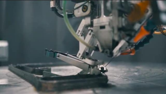 The Arevo process 3D printing with continuous carbon fiber strands. (Image from Arevo Labs video.)