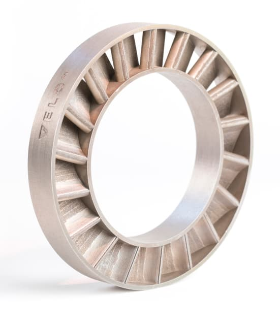 This part has not been post-processed. The angles and gaps in this Stator Ring cannot be printed without support structures on traditional PBF systems and, given the small gaps between each of the part's sections, may not be possible with PBF at all. (Image courtesy of Velo3D.)