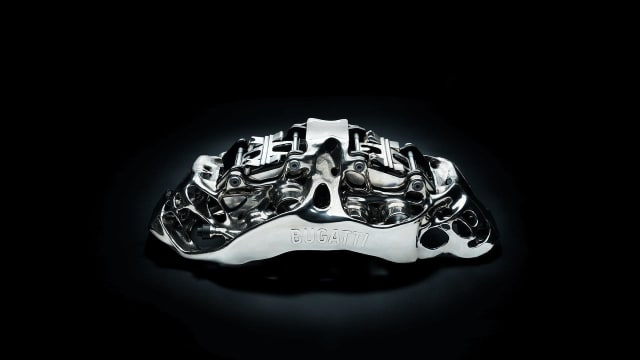 A 3D-printed brake caliper that is thought to be featured in Bugatti's latest luxury vehicle, the $12.5M La Voiture Noire. (Image courtesy of Bugatti.)