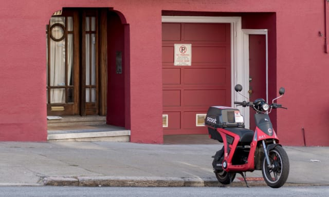 Just waiting for a rider. See a Scoot in San Francisco and you can ride it across town for as little as $3. It is turned on with an app. When you get to your destination, just leave it there for the next person. Really, who needs to buy a scooter when you can do this? (Picture courtesy of Scoot Networks)