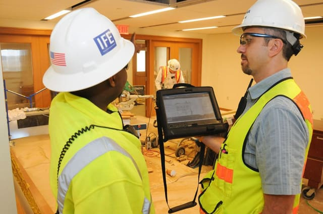 Lance Borst (right) and his team manage punch lists via tablet at the Novartis site in Cambridge, Massachusetts. (Image courtesy of Skanska.)