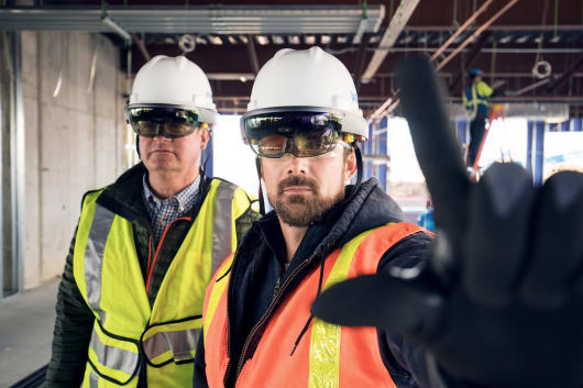 Wearing the HoloLens with ANSI-approved hardhat, construction workers can see and manipulate Revit models of the project they're working on using the Trimble Connect Hard Hat Solution for HoloLens. (Image courtesy of Trimble.)