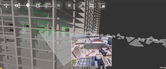 Clicking on one of the camera frustums (the pyramid-shaped objects hovering around the model) allows you to see a photograph of the site from that angle. (Image courtesy of Reconstruct.)