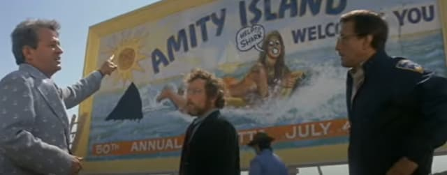 It's still out there. A scene from Jaws, where the chief of police and a scientist try to get the mayor of Amity Island, a seaside resort, to close the beaches because of a great white shark. (Image courtesy of Universal.)