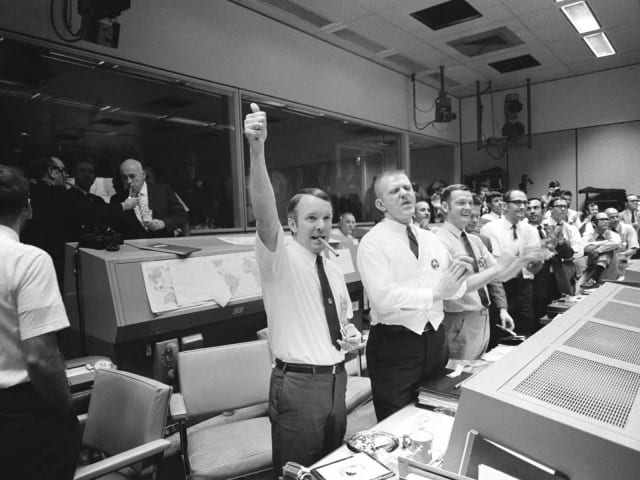 Mission Control celebrates the Apollo 13 splashdown. (Image courtesy of NASA.)