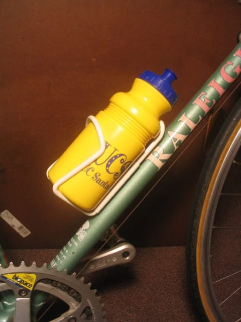 Example of a water bottle cage mounted on a bicycle. (Image courtesy of Wikipedia user Aezram.)