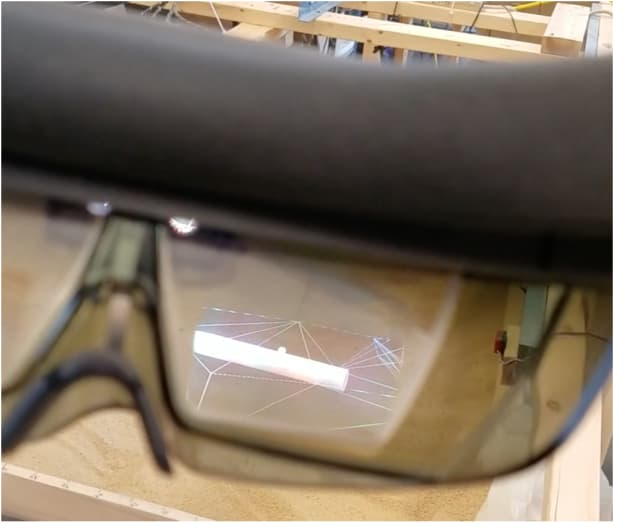 Through AR goggles, construction workers can view an image of a pipe buried beneath sand constructed from the cognitive GPR data. (Image from video courtesy of the University of Vermont and University of Tennessee at Chattanooga.)