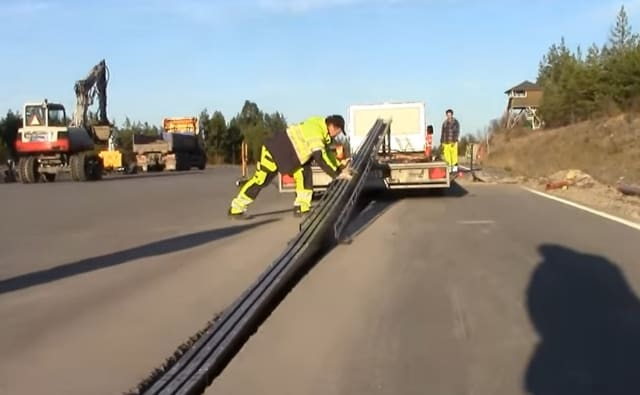 The Elways conductive track system being installed into a road in Sweden.