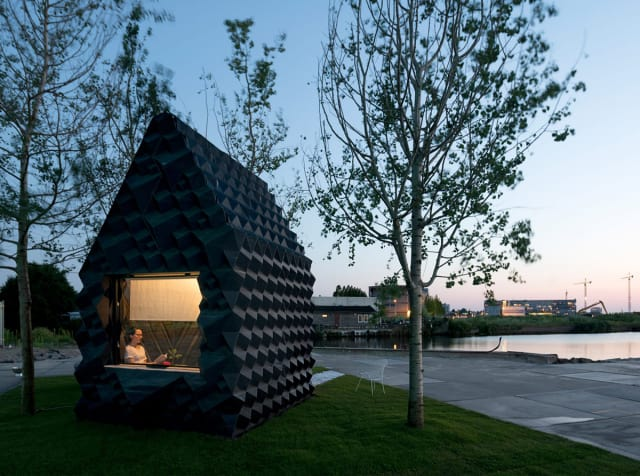 The 3D-printed micro-cabin contains 25 cubic meters of space and is made out of a plastic developed with partner Henkel. (Image courtesy of DUS Architects.)