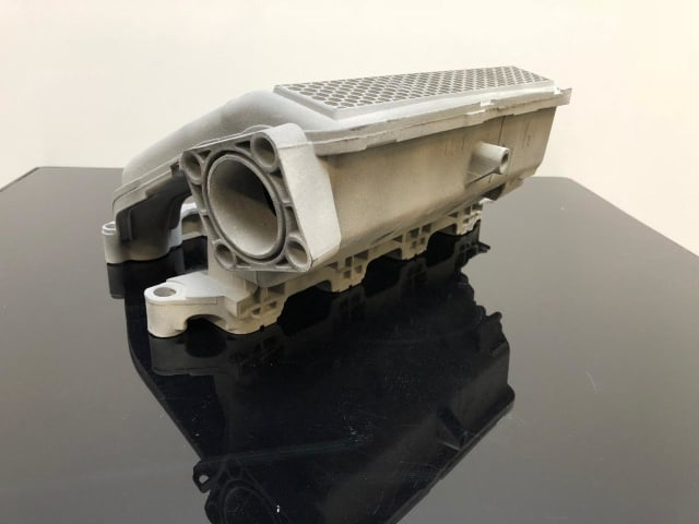 An engine manifold 3D printed by ZiggZagg, which allowed a racing team to finish in the top five thanks to better design. (Image courtesy of HP.)