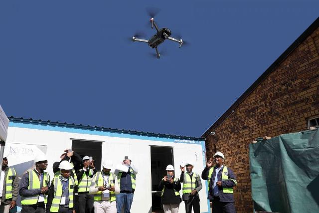 Officials launch the first drone of Gauteng's project into the sky above Johannesburg. (Image courtesy of CCE News.)