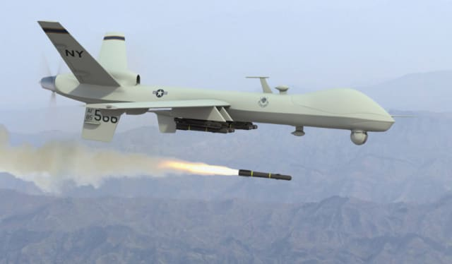 An MQ-1 Predator drone firing a Hellfire missile. (Image courtesy of the U.S. Air Force.)