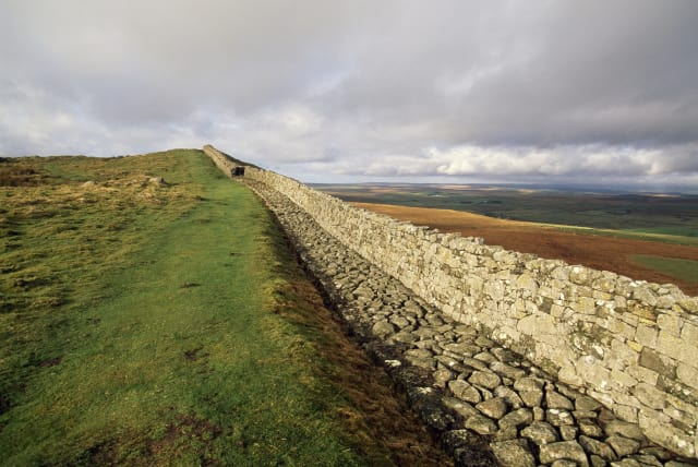 Modern ruins of Hadrian's Wall. (Image courtesy of history.com.)