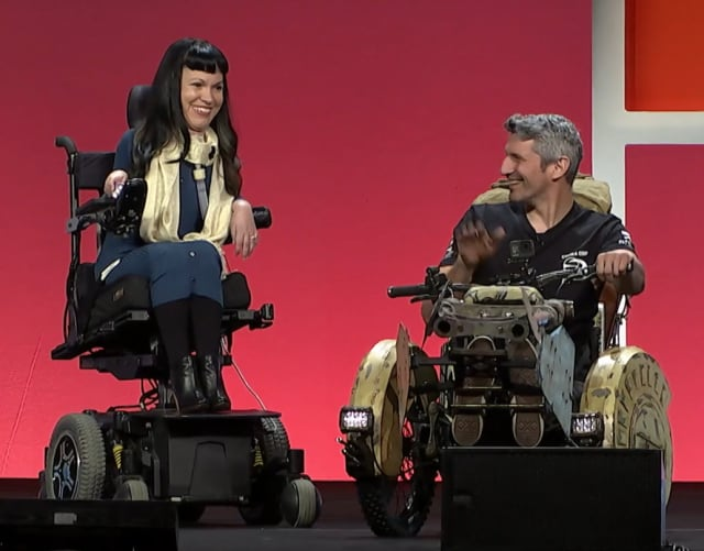 """Christine Getman, executive director of Magic Wheelchair, with Christian Bagg, who used a Marine Corp themed """"costume"""" on his downhill sports wheelchair."""