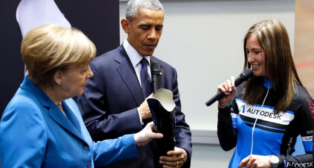 Paralympics cycling champ Denise Schindler with then-U.S. President Barack Obama, and Germany's chancellor Angela Merkel at Hannover Messe trade fair in 2016. (Image courtesy of USA Today.)