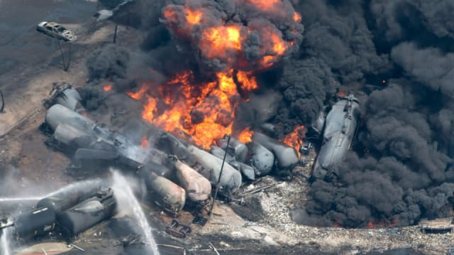 If oil catches fire during a train derailment, it can catch on fire and lead to an explosion. (Image courtesy of Paul Chiasson / THE CANADIAN PRESS.)