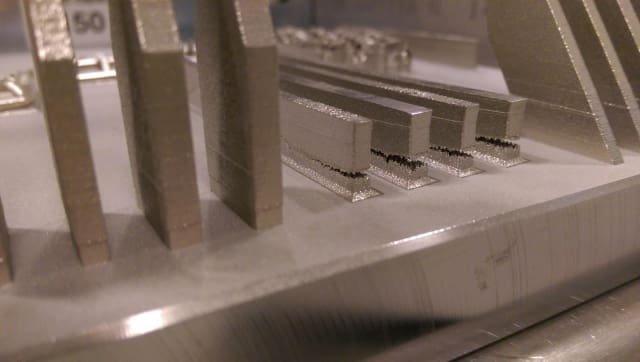 Stress has caused these metal bars to crack during the powder bed process. (Image courtesy of Albert To and University of Pittsburgh's Swanson School of Engineering.)