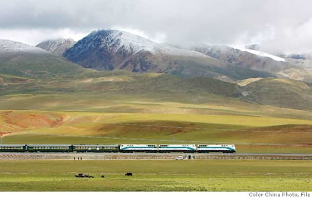 China's Lhasa Express in the Tibetan grass lands near Lhasa.(Image courtesy of AP Photo/Color China Photo.)