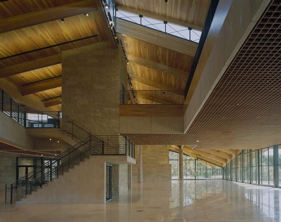 "The interior of the Indian Community School. The firm's website describes the site: ""A cross-pollination arises thorough the connection of learning spaces with the natural environment, allowing elements and phenomena outside to become a didactic influences within."" (Photo by Tim Hursley. Image courtesy of Antoine Predock Architect PC.)"