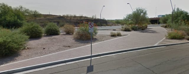 3Mixed messages. X shaped pathway in the wide median on Mill Avenue near the fatal accident invite crossing but signs dissuade it. (Picture courtesy of Google Maps)