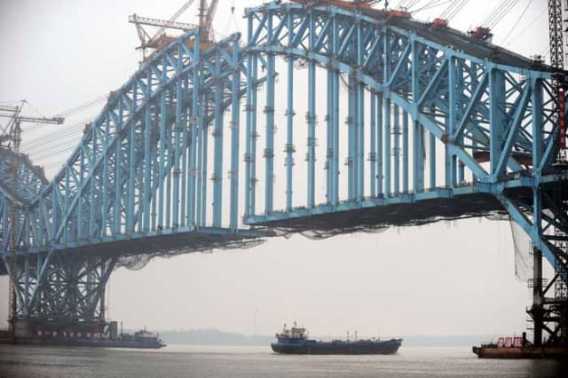 Building bridges: The Dashengguan Yangtze River Bridge under construction A section of the New Silk Road passes through Nanjing, capital of east China's Jiangsu Province on its way to London. (Image courtesy of SCMP.)