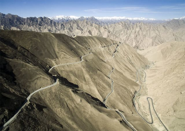 Taking the high road: The Xinjiang-Tibet Highway, part of the New Silk Road, crosses the TibetanPlateau. Elevation averages 4,500 meters., making it  one of the highest roads for vehicles in the world. (Image courtesy of SCMP.)