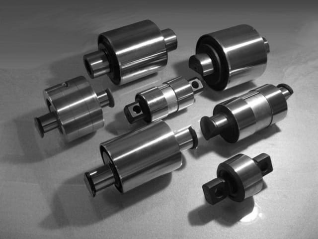 A collection of rubber bushings from SGA. Rubber bushings are placed between two metallic components to reduce vibration and noise. (Image courtesy of Società Gomma Antivibrante.)