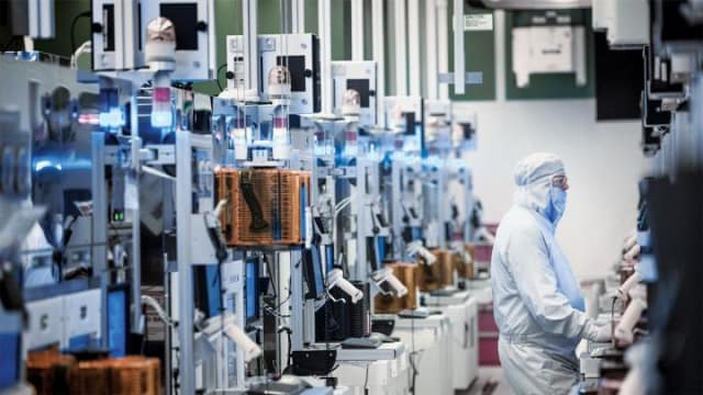 Inside a clean room at Intel, where microprocessors are assembled and inspected in clean rooms that require a degree of sanitation one thousand times greater than an operating room. (Image courtesy of Intel.)