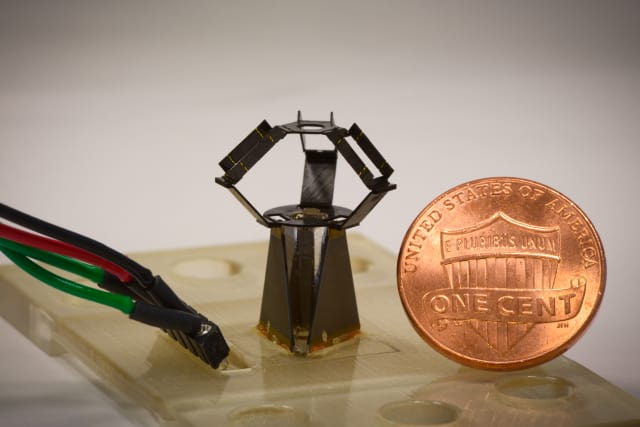 Completely unfolded, the milliDelta with 12 mm-by-15 mm-20 mm roughly compares to a cent piece, and uses piezoelectric actuators and flexural joints in its three arms to control high-frequency movements of a stage on top. (Image courtesy of Wyss Institute at Harvard University.)