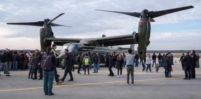 Excited visitors wait outside the crew door before entering to walk through an MV-22 Osprey at the Purdue University Airport. (Image courtesy of the Purdue Research Foundation.)
